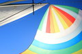 The wind has filled colorful spinnaker sail on sailing yacht detail of a against deep blue sky Stock Photos