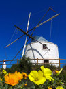 Wind mill in Algarve, Portugal Royalty Free Stock Images
