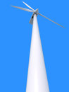 Wind power generator on blue background Stock Photo