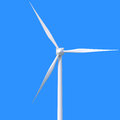 Wind power generator on blue background Royalty Free Stock Photo