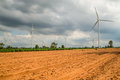Wind power installations in agriculture the country. Royalty Free Stock Photo