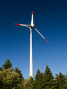 Wind power plant with trees Stock Photos
