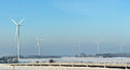 Wind power plant in winter time Royalty Free Stock Photo