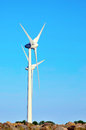 Wind power stations in a blue sky Stock Photo