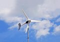 Wind power turbine on blue sky background Royalty Free Stock Image