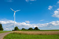 Wind power turbine in rural area on a sunny day Stock Images