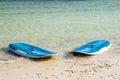 Wind surf board lying on a beach in watamu kenya Royalty Free Stock Photos
