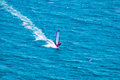 Wind surfer on blue sea Royalty Free Stock Photo