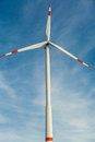 Wind turbine against a blue hazy sky in conceptual image of renewable and alternative energy resources to save the environment Royalty Free Stock Photography
