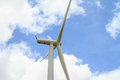Wind turbine against cloudy sky beautiful Stock Image