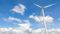 The wind turbine in beautiful cloudy blue sky background in Thai Royalty Free Stock Photo