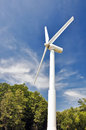 A wind turbine  with blue sky. Stock Images