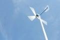 Wind turbine blue sky Royalty Free Stock Photo