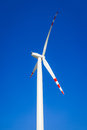 Wind turbine on blue sky without clouds Royalty Free Stock Photography
