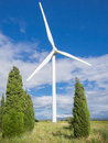 Wind turbine on blue sky with clouds Royalty Free Stock Photo