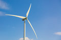 Wind turbine close up against blue sky with clouds Royalty Free Stock Photo