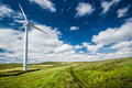 Wind turbine in countryside scenic view of green with blue sky and cloudscape background Stock Images