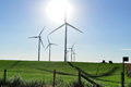 Wind turbine creating wind power modern windmills or turbines turn and create kinetic energy which is converted into Stock Images