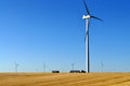 Wind turbine creating wind power modern windmills or turbines turn and create kinetic energy which is converted into Stock Photo