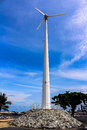 Wind turbine over the blue clouded sky backgrounds Royalty Free Stock Photos