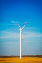 Wind turbine rolling in summer time Stock Images