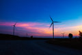 Wind turbine with the silhouette at sky. Royalty Free Stock Photo