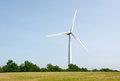 Wind turbine single on blue sky background and cornfield Stock Photography
