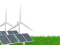 Wind turbine and solar panel on a grass field Stock Photos