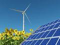 Wind turbine, solar panel and sunflowers Royalty Free Stock Photo