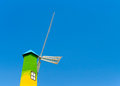 Wind turbine tower on blue sky background Royalty Free Stock Photo