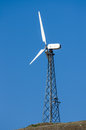 Wind turbine tower over the blue sky Stock Image