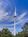 Wind turbine in the woods big towering over suburban Royalty Free Stock Photography