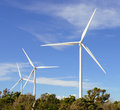 Wind turbines against blue sky Royalty Free Stock Photos