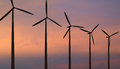 Wind turbines against red sky Stock Photography