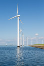 Wind turbines along dutch coast near urk row of Royalty Free Stock Images