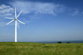 Wind turbines in china beautiful green meadow with generating electricity inner mongolia of Royalty Free Stock Images