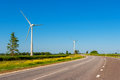 Wind turbines estonia landscape with highway and europe Royalty Free Stock Images