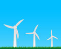 Wind turbines farm generating electricity on field Stock Images