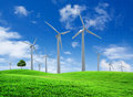 Wind turbines farm on green field Royalty Free Stock Photo