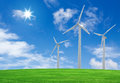 Wind turbines farm on green field Stock Images