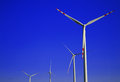 Wind turbines farm windmill over the blue sky Stock Photo