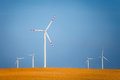 Wind turbines on a field Royalty Free Stock Images