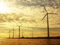 Wind turbines power generator farm in sea for renewable energy production along coast baltic near denmark at sunset sunrise Stock Image