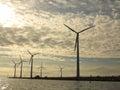 Wind turbines power generator farm in sea for renewable energy production along coast baltic near denmark at sunset sunrise Royalty Free Stock Image