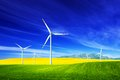 Wind turbines on spring field alternative clean energy and natural source of is gaining pupularity eco farm Stock Image