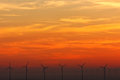 Wind turbines at sundown. Royalty Free Stock Photography