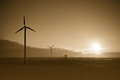 Wind turbines at sunset sepia view of in countryside Stock Images