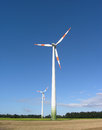 Wind turbines two in field in germany Royalty Free Stock Photo