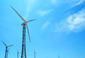 Wind turbines under the sunny sky Royalty Free Stock Photography