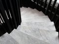 Winder steps which are curved in plan with marble step Stock Images